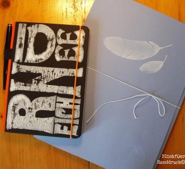 Notizbuch und Briefmappe